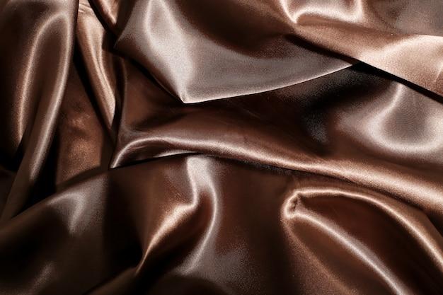 Fondo di struttura del tessuto di seta marrone