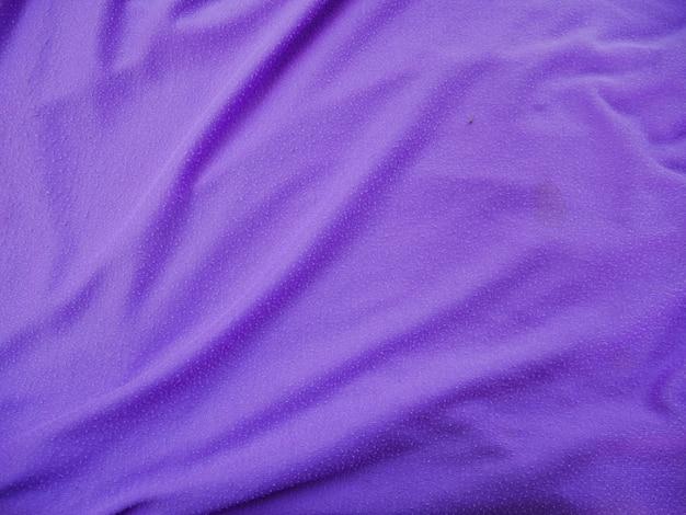 Fondo di struttura del tessuto di seta viola,