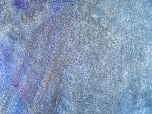 Fondo di struttura della parete dipinto blu invecchiato primo piano. gesso