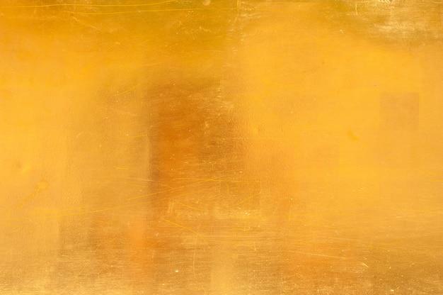 Fondo di struttura della parete dorata