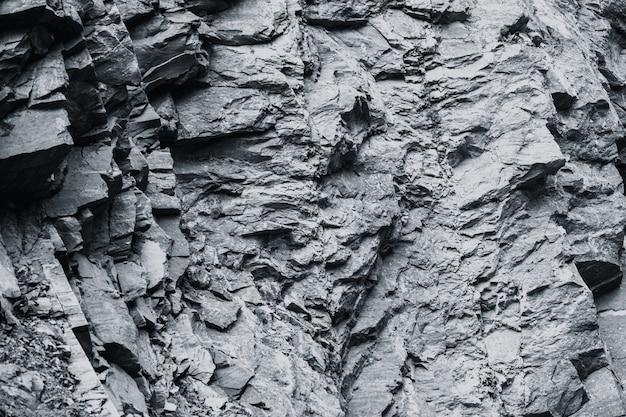 Fondo di struttura della roccia solida dura di pietra del granito