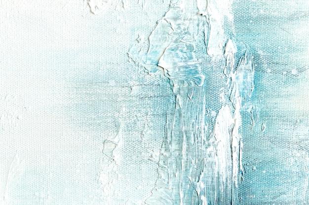 Fondo di struttura della tela con pittura blu variopinta astratta di arte.