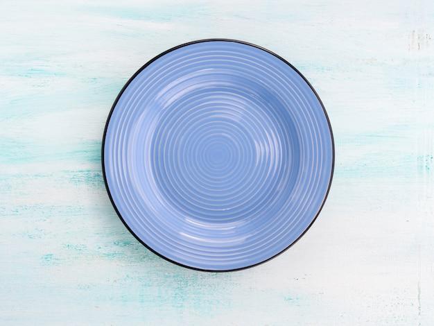 Fondo di vista superiore del piatto ceramico del piatto di colore pastello
