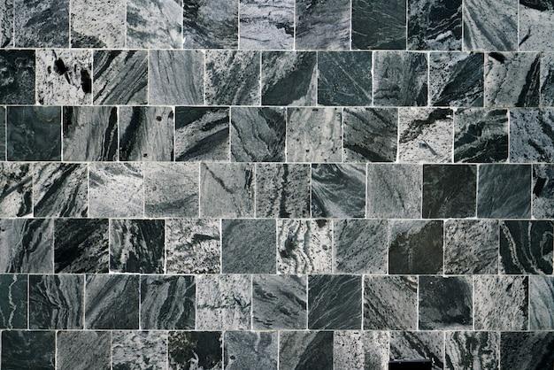 Fondo e carta da parati delle mattonelle del quadrato nero