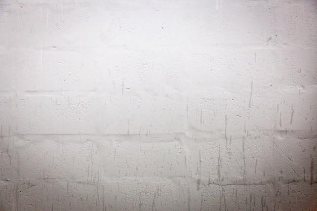 Fondo e struttura bianchi della parete del blocchetto di cenere
