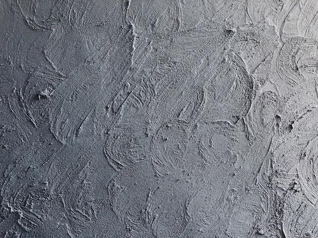 Fondo e struttura grigi dell'estratto della parete del cemento
