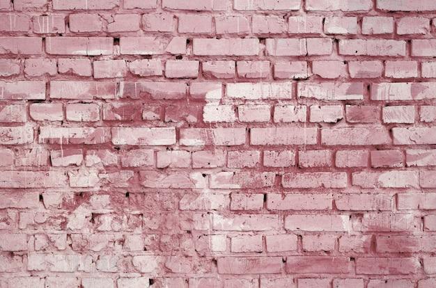 Fondo e struttura quadrati della parete del blocchetto del mattone. dipinto in rosso