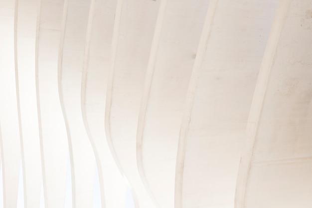 Fondo geometrico astratto senza cuciture bianco della parete