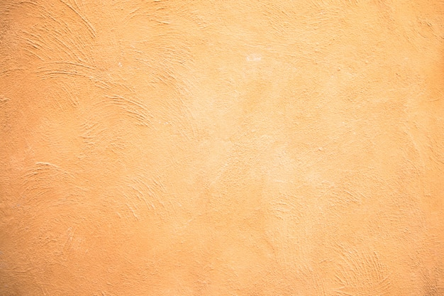 Fondo giallo astratto di struttura della parete del cemento