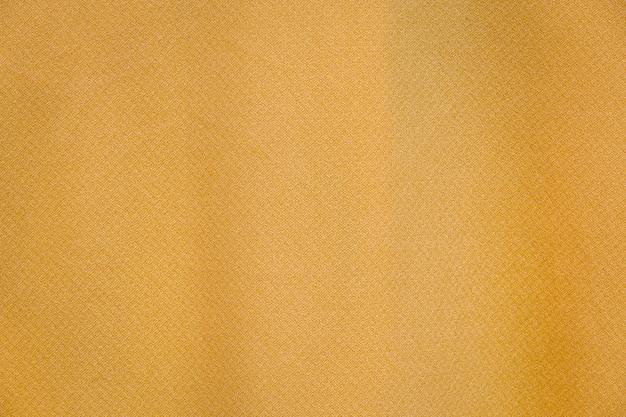Fondo giallo di struttura del panno del tessuto