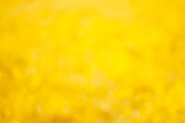 Fondo giallo e arancio vago vibrante brillante del bokeh