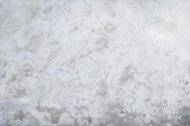 Fondo grigio bianco ruvido di struttura del pavimento del cemento di vecchio lerciume