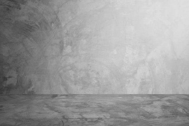 Fondo grigio della stanza dello studio e della parete del cemento