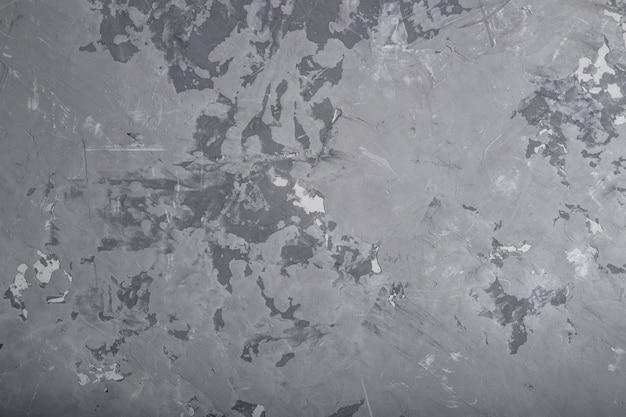Fondo grigio di struttura del muro di cemento grigio di lerciume.