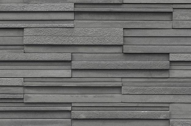 Fondo grigio di struttura della parete dell'ardesia del mattone
