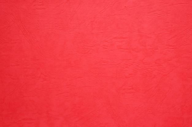 Fondo in bianco di struttura della carta rossa, fondo di natale