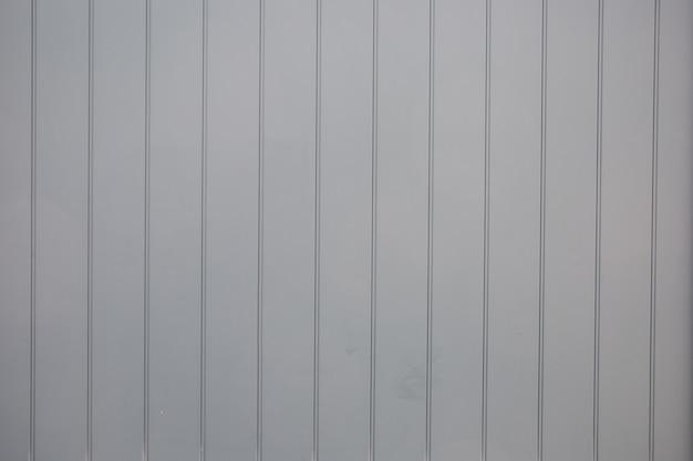 Fondo in bianco e nero della plancia di legno dipinta stagionata