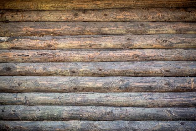 Fondo in legno vecchia parete di legno di una casa rustica con struttura