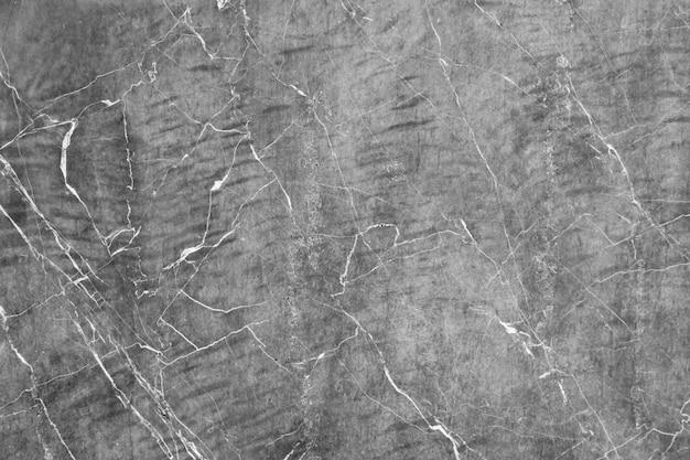 Fondo incrinato della parete di pietra concreta