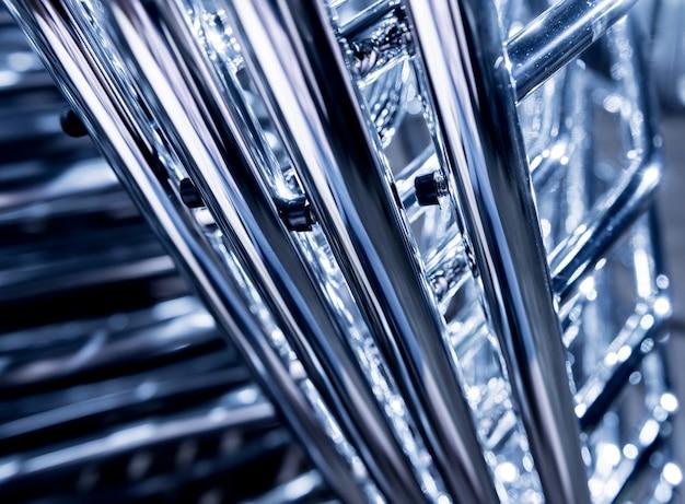 Fondo industriale astratto della costruzione di tubi metallici.