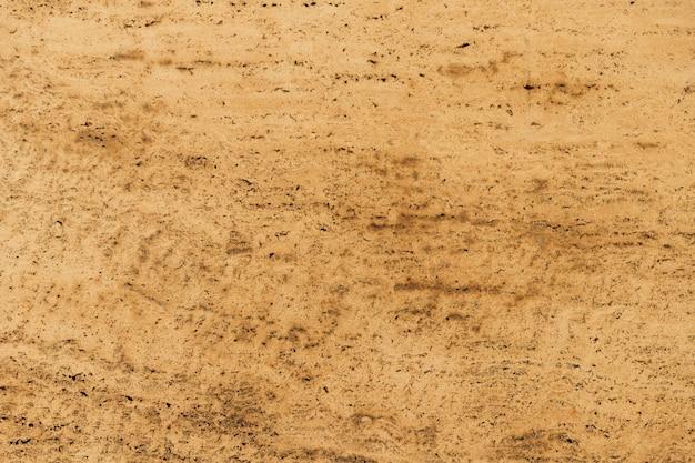 Fondo marrone chiaro di struttura della superficie del marmo