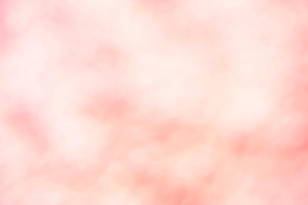 Fondo morbido molle rosa della carta da parati di colore pastello di pendenza della sfuocatura leggera.