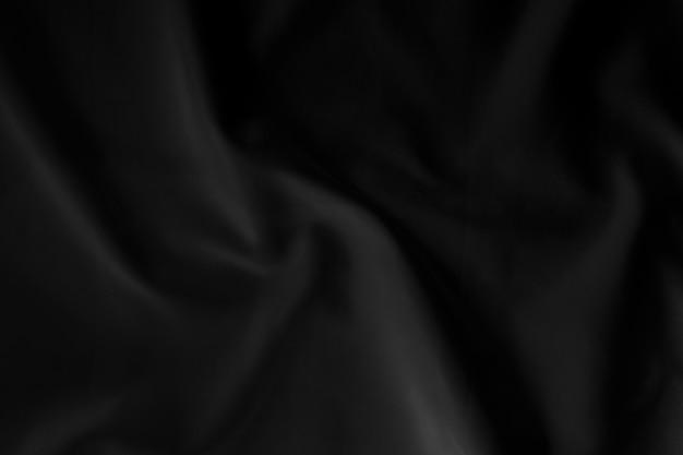 Fondo nero astratto di struttura del tessuto, panno di lusso o onda liquida