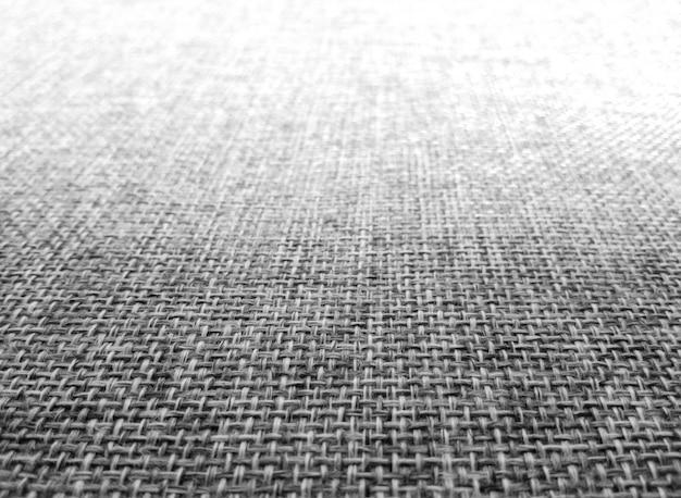 Fondo nero scuro e grigio astratto di struttura del tessuto.