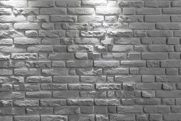 Fondo o struttura bianco del muro di mattoni.