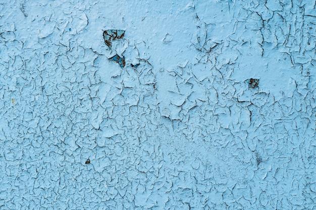 Fondo o struttura blu del metallo verniciato del grunge con i graffi e le crepe