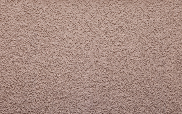 Fondo o struttura rosa-chiaro - parete intonacata con l'ornamento