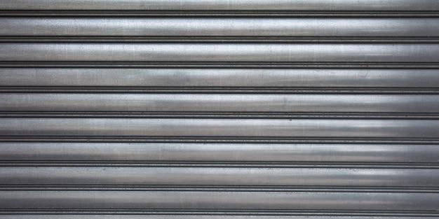 Fondo ondulato grigio dell'insegna grigia del metallo di struttura