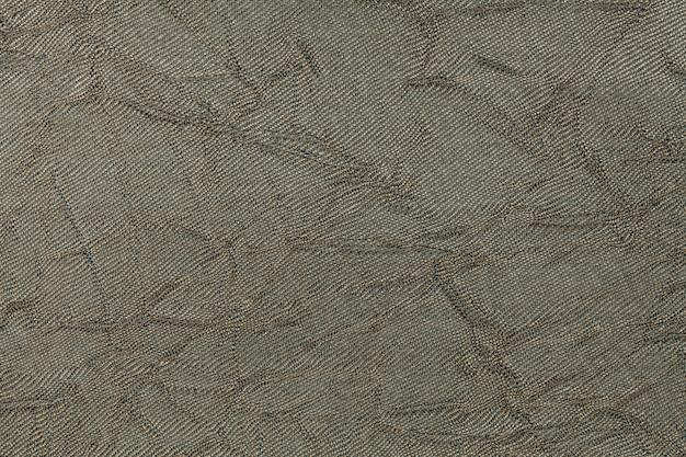 Fondo ondulato verde oliva da una materia tessile. tessuto con trama naturale primo piano.