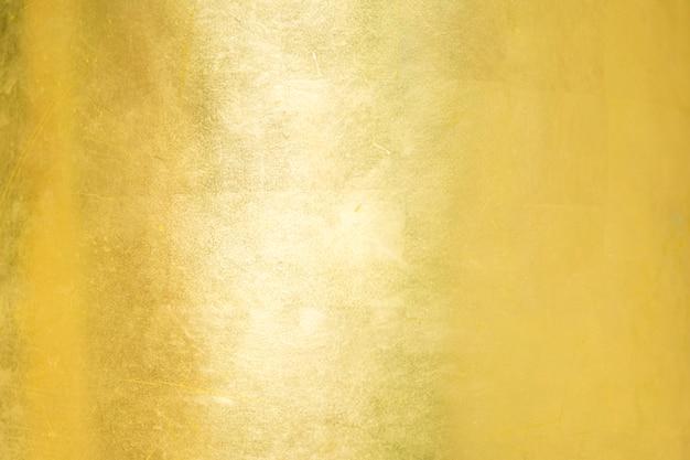 Fondo oro o texture e sfumature ombra.