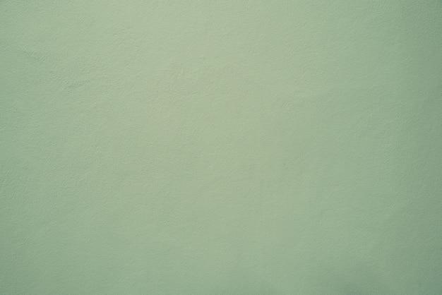 Fondo pastello molle verde di struttura del muro di cemento