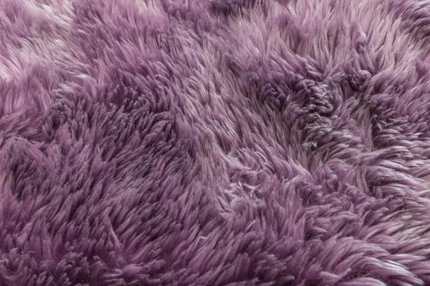 Fondo porpora di struttura del tappeto del primo piano
