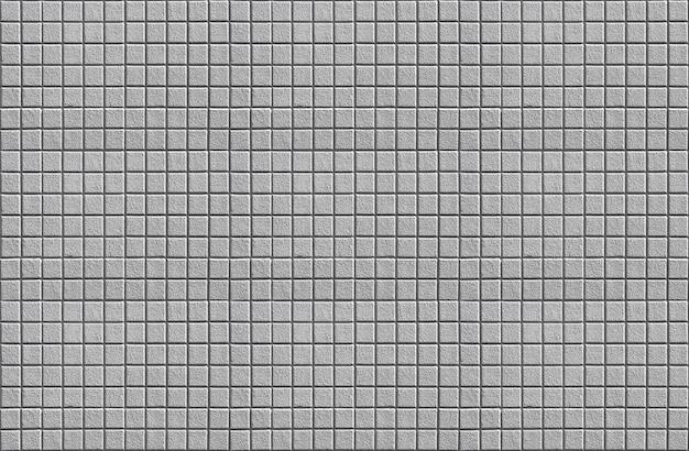 Fondo quadrato della parete di progettazione di struttura delle mattonelle del mattone del cemento della muratura della muratura grigia.