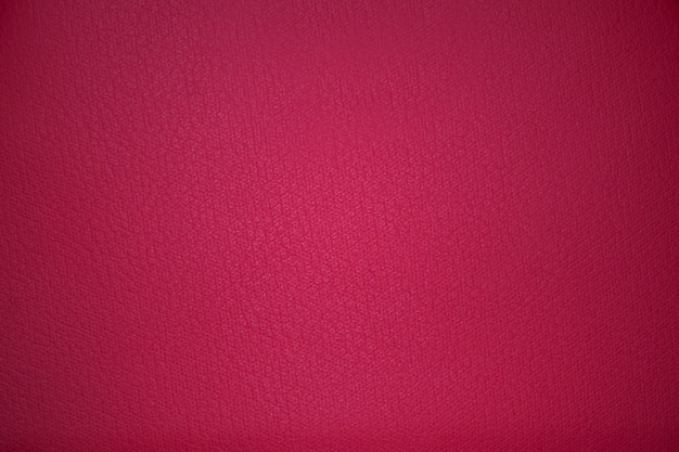 Fondo rosa di struttura del tessuto con vignettatura