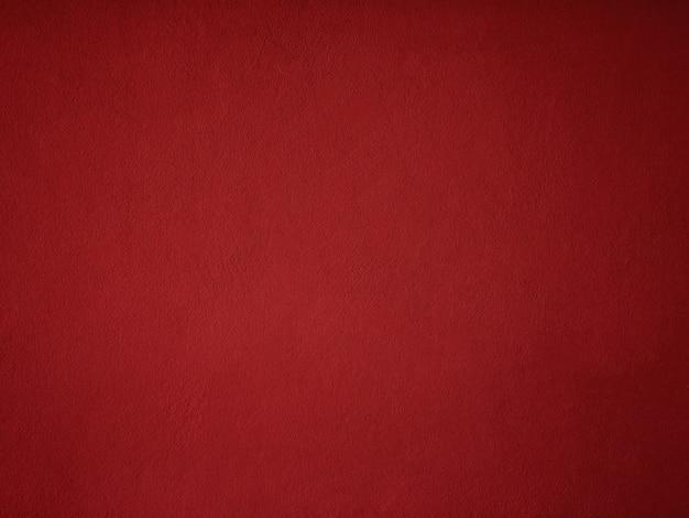 Fondo rosso della parete del cemento con spazio libero per testo.