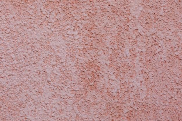 Fondo rosso di struttura della parete dello stucco