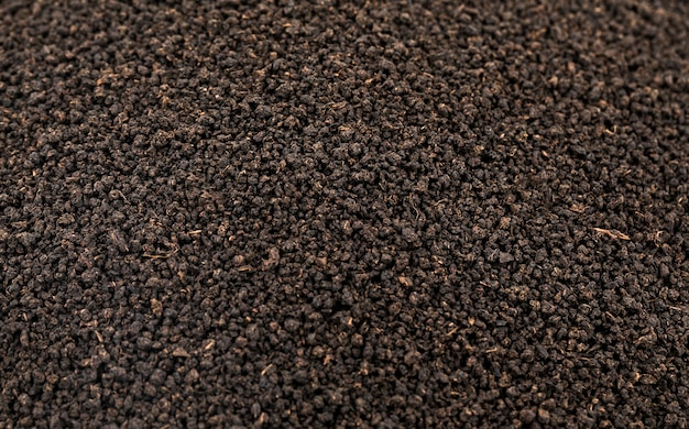Fondo sciolto o secco delle foglie di tè del tè nero aromatico