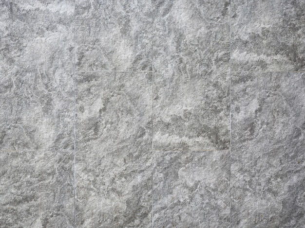 Fondo senza cuciture di struttura della parete grigia grigia astratta delle mattonelle.