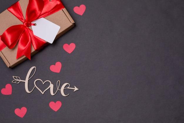 Fondo senza cuciture romantico di giorno di biglietti di s. valentino, arco dell'etichetta del regalo, presente, amore, cuori