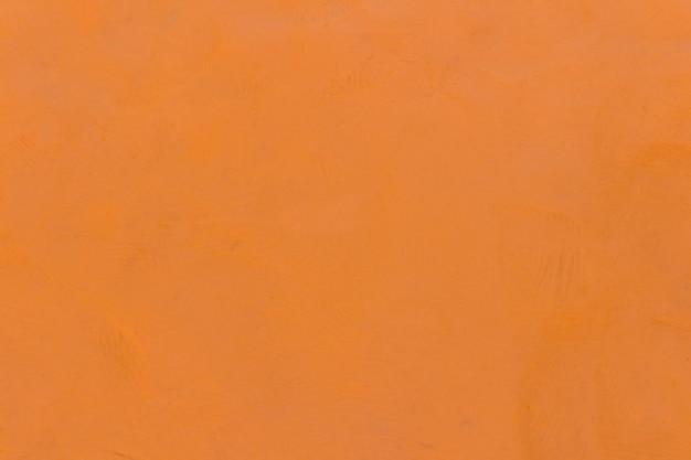 Fondo strutturato arancio della plastilina
