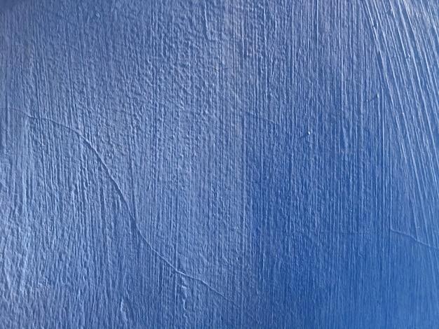Fondo strutturato blu del muro di cemento