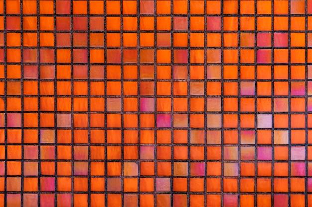 Fondo strutturato del mosaico arancio decorativo