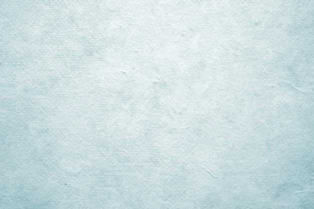 Fondo strutturato della carta d'annata blu in bianco