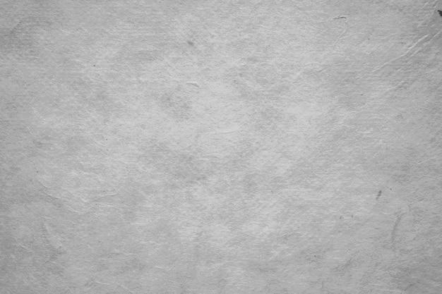 Fondo strutturato della carta di colore grigio in bianco