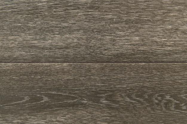 Fondo strutturato di legno grigio in bianco