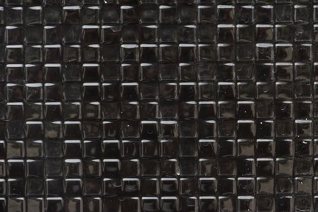 Fondo strutturato quadrato nero di textles